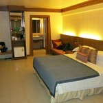  Contemporary Thai Deluxe Family - Bed and entrance to bathroom at centre of photo (I&#39;m a bit mes