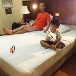  My hubby with our son, relaxing inside our room after a day of shopping and driving around Subic
