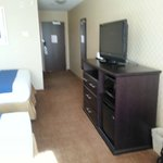  Nice storage unit with LCD TV. Microwave, fridge &amp; dresser w/ open storage