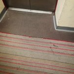 dirty carpet near elevator