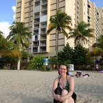  wife on beach in front of complex