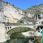 View of the Gorge du Tarn and the bridge into the village, from the swimming pool of the Auberge