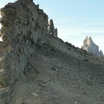 Wall-like sheets of 'minette' with Shiprock behind