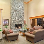Meet your party by the Rogue River rock fireplace.