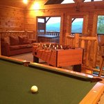 Play pool, looking over the mountains.