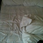 thin broken bed and duvet