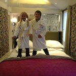  kids robes and slippers on parents bed!!