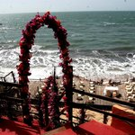  View of the hotel deck on the beach set for wedding