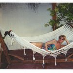  Sis relaxing in a hammock