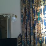 fussy curtains and dated decor not as shown on website