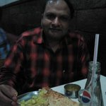 Enjoying Rava masala dosa