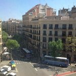 This is a view from hotel room (upper hotel entrance). Go right way and find Paseo de Gracia, th