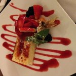 Cheesecake brulé with strawberry coulis.