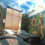 "The tiny ""relaxation room"" .. yes garish sunflowers and a badly painted sky..."