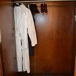 In the closet, bathrobes are available for guest's comfort.