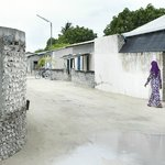 A local woman walking through the streets near the Guest house on the streets on Hanimaadhoo Isl