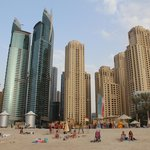  the beach is side by side with skyscrapers)
