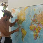CEO Scott Woodhams of Central America Overland Expeditions points to a map