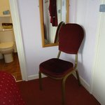 Note proximity of door to chair and bathroom.