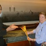  Roger, of the hotel staff, presents a rose on Sant Jordi Day