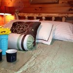 Sleep Number Beds set inside of hewn log frames - standard in each Timber Wolf Lodge master bedr