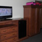 TV and dresser/wardrobe with fridge