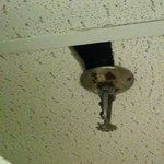  hole in ceiling near sprinkler