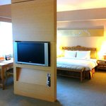 Suite room with adjusting tv board