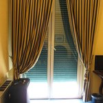 Beautiful drapes and external window shutters