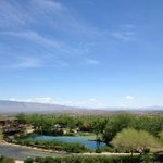 View of the moutains, infinity pond and golf green from our room balcony
