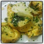 Tortelloni filled with goats cheese and asparagus, tossed in butter and sage.