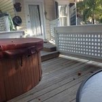 View of the private deck that includes a 2 person tub, and an outside shower