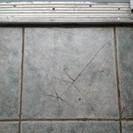  Cracked tiles and dirty doorstep