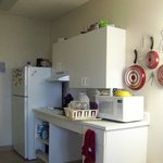"This is my  kitchen in the ADA room. I use my own pots and pans. They allowed me to ""dress"" my r"