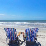 We have beach chairs already here waiting for you.  ;o)