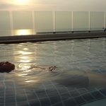 Relaxing in the infinity pool at sunset