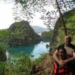  my husband and i with kayangan lake on the foreground