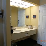 Vanity outside of small bathroom
