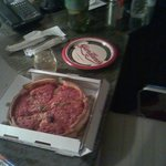 Enjoying a Giordano's pizza at my desk.