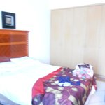 Bedroom with doublebed and single bed, safe in the wardrobe and dressing table.