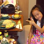 Daughter with her favorite thing 'Room Service Food""