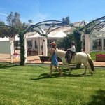 Me taking my son on a pony ride round the pools. €5, fab!