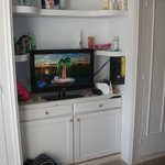  tv between the cupboards and drawers