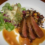 Dinner of locally raised ostrich with wild rice and greens with lemongrass dressing.