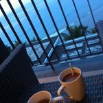  have tea with beautiful sunset scenary view