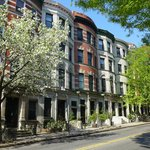 Brownstone Houses at W141st Street - The inn is the middle red brick building