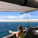 a lunch trip to the sandbar on their own dhow boat