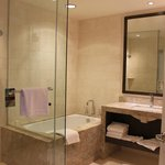 2nd bathroom.  Note full size bathtub and glass shower, 2 sinks, plush towels and robes
