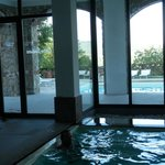  View of indoor pool, loking out to outdoor pool