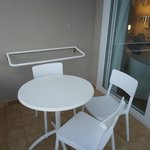 Balcony with table and chairs and towel dryer